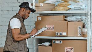 man checking shipping report